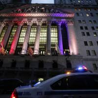 Photo -   A police car patrols in front of the New York Stock Exchange, Wednesday, Oct. 31, 2012 before it reopens for trading for the first time this week following a two-day shutdown due to superstorm Sandy. Stock futures are rising ahead of the opening bell. Much of lower Manhattan and the financial district are still without electrical power. (AP Photo/Mark Lennihan)