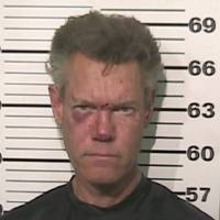 Photo - FILE - This file photo provided by the Grayson County, Texas, Sheriff's Office shows Country singer Randy Travis. A prosecutor says the country music star is expected to enter a guilty plea in a drunken-driving case in North Texas. (AP Photo/Grayson County Sheriff's Office)