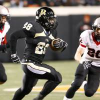 Photo -  OSU running back Devon Thomas, shown here playing for Broken Arrow, is facing an unknown future with the Cowboys after his arrest. MATT BARNARD/Tulsa World
