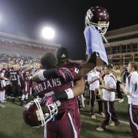 Photo - CLASS 6A HIGH SCHOOL FOOTBALL STATE CHAMPIONSHIP GAME / CELEBRATION: Jenks' Jordan Smallwood (2) and Trey'Vonne Barr'e (5) celebrate the win over Norman North during the Class 6A Oklahoma state championship football game between Norman North High School and Jenks High School at Boone Pickens Stadium on Friday, Nov. 30, 2012, in Stillwater, Okla.   Photo by Chris Landsberger, The Oklahoman