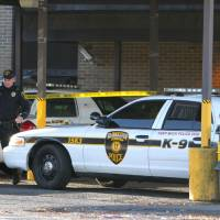Photo - Authorities continue their investigation where three officers have been injured in a shooting at the Gloucester Township police station, and the suspect was shot and killed, Friday, Dec. 28, 2012, in Gloucester Township, N.J. (AP Photo/South Jersey Times, Lori M. Nichols) PHILLY METRO OUT NEWS