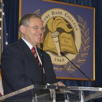 Photo - In this Jan. 31, 2010, image released by Miami Dade College, shows Sen. Robert Menendez, D-N.J., speaks at the signing of his book
