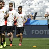 Photo - Belgium's Thomas Vermaelen,  from left to right, Toby Alderweireld, Kevin De Bruyne, Eden Hazard and Nicolas Lombaerts, run during a training session at the Mineirao Stadium in Belo Horizonte, Brazil, Monday, June 16, 2014.  Belgium will play in group H of the Brazil 2014 soccer World Cup.  (AP Photo/Bruno Magalhaes)