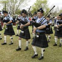Photo -  Members of the Oklahoma Scottish Pipes and Drums perform during the 2013 Iron Thistle Scottish Heritage Festival in Yukon. Photo by Paul Hellstern, The Oklahoman Archives   PAUL HELLSTERN -