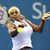 Photo - Serena Williams of the U.S. plays a shot in her quarter final match against Dominika Cibulkova of Slovakia during the Brisbane International tennis tournament in Brisbane, Australia, Thursday,  Jan. 2, 2014. (AP Photo/Tertius Pickard)
