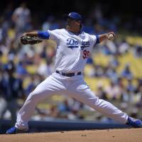 Photo - Los Angeles Dodgers starting pitcher Hyun-Jin Ryu, of South Korea, throws to the plate during the first inning of a baseball game against the San Diego Padres, Sunday, July 13, 2014, in Los Angeles. (AP Photo/Mark J. Terrill)
