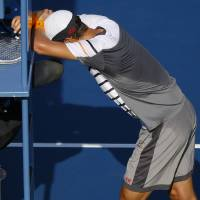 Photo - Tomas Berdych, of the Czech Republic, reacts after the chair umpire ruled that a ball hit by Marin Cilic, of Croatia, bounced twice before hitting Berdych's racket during the quarterfinals of the 2014 U.S. Open tennis tournament, Thursday, Sept. 4, 2014, in New York. (AP Photo/Seth Wenig)