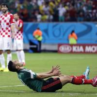 Photo - Mexico's Oribe Peralta reacts after missing a chance during the group A World Cup soccer match between Croatia and Mexico at the Arena Pernambuco in Recife, Brazil, Monday, June 23, 2014. (AP Photo/Sergei Grits)