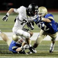 Photo - Derrick Briggs , left, and an unidentified Choctaw player try to bring down McAlester's Caden Pratt (7) during a high school football scrimmage at Harve Collins Field at Norman High School on Friday, Aug. 24, 2012, in Norman, Okla.  Photo by Steve Sisney, The Oklahoman