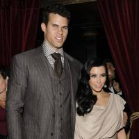 Photo - FILE - This Aug. 31, 2011 file photo shows newlyweds Kim Kardashian and Kris Humphries attending a party thrown in their honor at Capitale in New York. A Los Angeles judge has approved a divorce settlement between Kim Kardashian and Kris Humphries. Details of the agreement were not disclosed in a brief court hearing Friday, April 19, 2013, but the judge said he felt that settlement talks had led to resolution. The divorce will become final once papers are prepared and signed by the parties. Kardashian and Humphries were married in August 2011.  She filed for divorce in October 2011. (AP Photo/Evan Agostini, file)