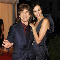 Photo - FILE - This May 7, 2012 file photo shows singer Mick Jagger, left, and L'Wren Scott at the Metropolitan Museum of Art Costume Institute gala benefit, celebrating Elsa Schiaparelli and Miuccia Prada, in New York. Scott, a fashion designer, was found dead Monday, March 17, 2014, in Manhattan of a possible suicide. (AP Photo/Evan Agostini, File)