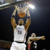 Photo - Oklahoma City's Etan Thomas dunks the ball over Miami's Udonis Haslem during a preseason NBA basketball game between the Oklahoma City Thunder and the Miami Heat at the BOK Center in Tulsa, Okla., Wednesday, October 14, 2009. Photo by Bryan Terry, The Oklahoman ORG XMIT: KOD