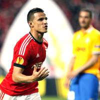 Photo - Benfica's Lima, from Brazil, celebrates after scoring his side's second goal against Juventus during the Europa League semifinal first leg soccer match between Benfica and Juventus at Benfica's Luz stadium in Lisbon, Thursday, April 24, 2014. (AP Photo/Francisco Seco)