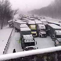 Photo - This cell phone image shows a massive highway pileup on Interstate 94 near Michigan City, Ind., Thursday, Jan. 23, 2014, that is being blamed on whiteout conditions. The accident has left at least two people dead and an unknown number injured in northwestern Indiana.  Indiana State Police say they have closed Interstate 94 eastbound and are bringing in cranes and wreckers to help clear the scene. (AP Photo/Sun-Times Media, Matt Carpenter) MANDATORY CREDIT, MAGS OUT