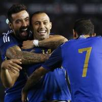 Photo - Argentina's Javier Mascherano, center, celebrates scoring against Trinidad and Tobago with teammates Ezequiel Lavezzi, left, and Angel Di Maria during an international friendly soccer match in Buenos Aires, Argentina, Wednesday, June 4, 2014. (AP Photo/Natacha Pisarenko)