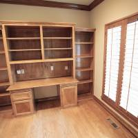 Photo - The study of the foreclosed house at 8012 NE 140 features wall-to-wall bookshelves over and around the desk area.