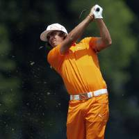 Photo -   Rickie Fowler shoots from the first fairway during the final round of the Wells Fargo Championship golf tournament at Quail Hollow Club in Charlotte, N.C., Sunday, May 6, 2012. (AP Photo/Gerry Broome)