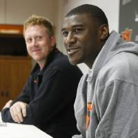 Photo - Oklahoma State All-America receiver Justin Blackmon, right, answers a question at a news conference in Stillwater. Both he and quarterback Brandon Weeden, left, will return for another season. AP Photo