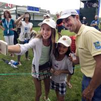 Photo - Canada's Mike Weir, of Canada, poses for a selfie with Kaylee Chin, left, and Maya Cunningham, center, during the pro-am event at the Canadian Open golf championship Wednesday, July 23, 2014 at Royal Montreal golf club in Montreal. (AP Photo/The Canadian Press, Ryan Remiorz)