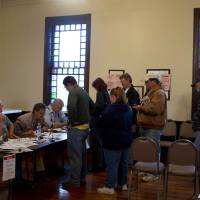 Photo -   Voters line up to cast ballots at Kanwaka Township Hall near Lawrence, Kan., Tuesday, Nov. 6, 2012. (AP Photo/Orlin Wagner)