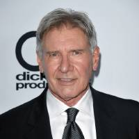 Photo - FILE - In this Oct. 21, 2013 file photo, Harrison Ford arrives at the 17th Annual Hollywood Film Awards Gala at the Beverly Hilton Hotel in Beverly Hills, Calif. After months of carefully guarded secrecy and endless Internet speculation, the cast of the latest incarnation of the space epic,