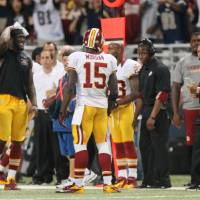 Photo -   The Washington Redskins sideline including head coach Mike Shanahan, right, reacts after wide receiver Joshua Morgan (15) picked up an unsportsmanlike conduct penalty for throwing the ball at an opposing player during the fourth quarter action against the St. Louis Rams in an NFL football game on Sunday, Sept. 16, 2012 at the Edward Jones Dome in St. Louis. (AP Photo/St. Louis Post-Dispatch, Chris Lee) EDWARDSVILLE INTELLIGENCER OUT; THE ALTON TELEGRAPH OUT