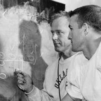 Photo - UNIVERSITY OF OKLAHOMA / OU / COLLEGE FOOTBALL: Oklahoma University football coach Bud Wilkinson goes over a play with quarterback Jimmy Harris as the Sooners wind up preparations for the Colorado game at Boulder, Nov. 1, 1956. (AP Photo)ORG XMIT: APHS5457