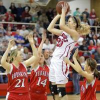 Photo - Washington's Lacey Paulk puts up a shot between Kingston's Tara McGahey, left, Raegan Wigley, center, and Rachel Adkins during a girls high school basketball game in Washington, Okla., Friday, Feb. 17, 2012. Photo by Bryan Terry, The Oklahoman