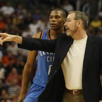 Photo - PRESEASON NBA BASKETBALL GAME: Oklahoma City Thunder head coach P.J. Carlesimo, right, talks with his guard Russell Westbrook in the third quarter against the Phoenix Suns during an NBA exhibition basketball game on Thursday, Oct. 23, 2008, in Phoenix.  (AP Photo/Rick Scuteri)  ORG XMIT: AZRS106