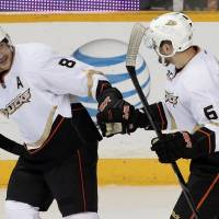 Photo - Anaheim Ducks right wing Teemu Selanne (8), of Finland, celebrates with Patrick Maroon (62) after Selanne scored against the Nashville Predators in the second period of an NHL hockey game Thursday, Jan. 9, 2014, in Nashville, Tenn. (AP Photo/Mark Humphrey)