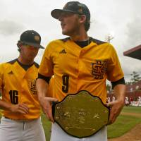 Photo - Kennesaw State's Will Lowman (16) helps winning pitcher Travis Bergen (9) adjust his championship belt after an NCAA college baseball tournament regionalgame against Alabama on Friday, May 30, 2014 in Tallahassee, Fla. Kennesaw State awards the belt to the player of the game when they win. Kennesaw State won 1-0. (AP Photo/Phil Sears)