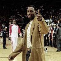 Photo - Houston Rockets' Tracy McGrady gives a thumbs up to fans as he enters the court before a NBA basketball game against the Portland Trail Blazers on Saturday, Oct. 31, 2009 in Houston. McGrady is rehabbing off-season micro-fracture surgery. (AP Photo/Bob Levey) ORG XMIT: TXBL115