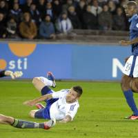 Photo -   France's Abou Diaby (R) scores the first goal past Finland's goalie Lukas Hradecky (L) and defender Joona Toivio during first half of the FIFA World Cup 2014 qualification match Finland vs France in Helsinki on Friday, Sept 7 2012. (AP Photo/Jussi Nukari, Lehtikuva) FINLAND OUT