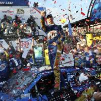 Photo -   Brad Keselowski celebrates his win in victory lane at the NASCAR Sprint Cup Series auto race at Dover International Speedway, Sunday, Sept. 30, 2012, in Dover, Del. (AP Photo/The Wilmington News-Journal, Daniel Sato) NO SALES