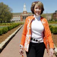 Photo -  Ann Hargis, the first lady of Oklahoma State University, walks across campus in Stillwater. Photo by KT King, The Oklahoman   KT King -