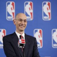 Photo - FILE - In this May 20, 2014, file photo, NBA Commissioner Adam Silver answers questions from the media during a news conference before the NBA Draft Lottery in New York. Speaking to The Associated Press on Friday, June 6, 2014, at an NBA Cares event, Silver said he's thrilled that the league's attention can be on the championship series between the Miami Heat and San Antonio Spurs _ and not, as it was for so much of the postseason, on the off-the-court matters involving the banishment of Los Angeles Clippers owner Donald Sterling and now the looming sale of that franchise. (AP Photo/Kathy Willens, File)