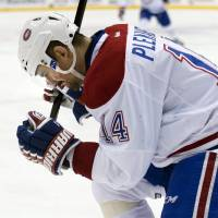 Photo - Montreal Canadiens forward Tomas Plekanec celebrates his game-winning goal against the Toronto Maple Leafs during their third period of an NHL hockey game in Toronto on Saturday, March 22, 2014. (AP Photo/The Canadian Press, Nathan Denette)