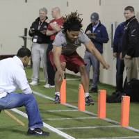 Photo -  Oklahoma football player Dominique Whaley runs a drill during pro day for NFL scouts at the Everest Indoor Center in Norman, Okla. on Wednesday, March 12, 2014. (AP Photo/Alonzo Adams)