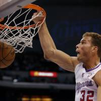 Photo -   Los Angeles Clippers' Blake Griffin dunks in the first half of an NBA basketball game against the Chicago Bulls in Los Angeles, Saturday, Nov. 17, 2012. (AP Photo/Jae C. Hong)