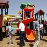 Photo -  Edmond Rotary Club members participated in the dedication of playground equipment donated by Rotary clubs to the new Edmond 66 Park. Photo by Jim Beckel, The Oklahoman   Jim Beckel -  THE OKLAHOMAN