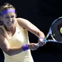 Photo - Victoria Azarenka of Belarus serves to Jamie Hampton of the US during their third round match at the Australian Open tennis championship in Melbourne, Australia, Saturday, Jan. 19, 2013. (AP Photo/Andy Wong)