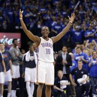 Photo - NBA BASKETBALL: NBA BASKETBALL: Oklahoma City's Reggie Jackson (15) pumps up the crowd as Memphis takes three free throws in the final seconds during the second round NBA playoff basketball game between the Oklahoma City Thunder and the Memphis Grizzlies at Chesapeake Energy Arena in Oklahoma City, Sunday, May 5, 2013. Photo by Chris Landsberger, The Oklahoman