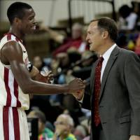 Photo - Oklahoma head coach Lon Kruger shakes hands with his leading scorer Buddy Hield as the University of Oklahoma (OU) Sooners men's basketball team defeats  the Central Oklahoma Bronchos 94-66 at McCasland Field House on Wednesday, Nov. 7, 2012  in Norman, Okla. Photo by Steve Sisney, The Oklahoman
