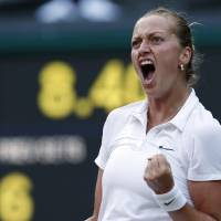 Photo - Petra Kvitova of Czech Republic celebrates winning a point against Barbora Zahlavova Strycova of Czech Republic in their women's singles match at the All England Lawn Tennis Championships in Wimbledon, London, Tuesday July 1, 2014. (AP Photo/Ben Curtis)