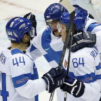 Photo - Team Finland celebrates a first period goal against Austria during a men's ice hockey game at the 2014 Winter Olympics, Thursday, Feb. 13, 2014, in Sochi, Russia. (AP Photo/Mark Humphrey)