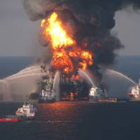 Photo -   FILE - In this April 21, 2010 file image provided by the U.S. Coast Guard, fire boat response crews battle the blazing remnants of the off shore oil rig Deepwater Horizon. British oil company BP said Thursday Nov. 15, 2012 it is in advanced talks with U.S. agencies about settling criminal and other claims from the Gulf of Mexico well blowout two years ago. In a statement, BP said