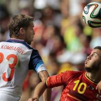 Photo - Belgium's Eden Hazard, right, battles for the ball with Russia's Dmitry Kombarov during the group H World Cup soccer match between Belgium and Russia at the Maracana stadium in Rio de Janeiro, Brazil, Sunday, June 22, 2014. (AP Photo/Ivan Sekretarev)