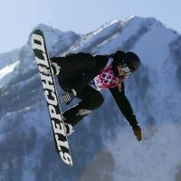Photo - New Zealand's Rebecca Torr takes a jump during the women's snowboard slopestyle qualifying at the Rosa Khutor Extreme Park ahead of the 2014 Winter Olympics, Thursday, Feb. 6, 2014, in Krasnaya Polyana, Russia.  (AP Photo/Sergei Grits)