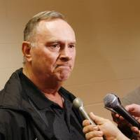 Photo - New OSU college football defensive coordinator Bill Young answers questions from the media  in the media room at Gallagher-Iba Arena on the campus of Oklahoma State University in Stillwater, Okla., Friday, January 23, 2009. BY NATE BILLINGS, THE OKLAHOMAN ORG XMIT: KOD