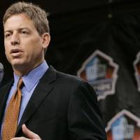 Photo - Former Dallas Cowboys quarterback Troy Aikman talks about his career after being named as a member of the Pro Football Hall of Fame class of 2006 on Saturday, Feb. 4, 2006 in Detroit. (AP Photo/Jeff Roberson)
